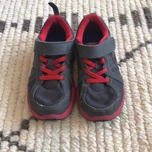 Boys slip on NIKE tennis shoes size 11.5